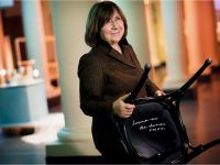 Svetlana Alexievich with the autographed chair at the Nobel Museum in Stockholm, 6 December 2015. Copyright © Nobel Media AВ 2015 Photo: Alexander Mahmoud