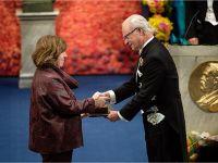 Svetlana Alexievich receiving her Nobel Prize from H.M. King Carl XVI Gustaf of Sweden at the Stockholm Concert Hall, 10 December 2015 Copyright © Nobel Media AB 2015 Photo: Pi Frisk