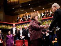 Svetlana Alexievich receiving her Nobel Prize from H.M. King Carl XVI Gustaf of Sweden at the Stockholm Concert Hall, 10 December 2015. Copyright © Nobel Media AB 2015 Photo: Pi Frisk