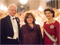 The Swedish Royal Family receives the Laureates and their significant others in the Prince_s Gallery. From left to right: King Carl XVI Gustaf of Sweden, Literature Laureate Svetlana Alexievich and Queen Silvia of Sweden<br> Copyright © Nobel Media AB 2015<br>Photo: Alexander Mahmoud