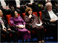 Nobel Laureates seated on stage. From left: Medicine Laureates Satoshi Ōmura and Youyou Tu, Literature Laureate Svetlana Alexievich and Laureate in Economic Sciences Angus Deaton<br>Copyright © Nobel Media AB 2015<br>Photo: Pi Frisk